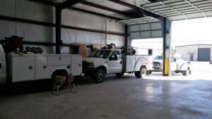 Adams Mobile Air trucks at shop